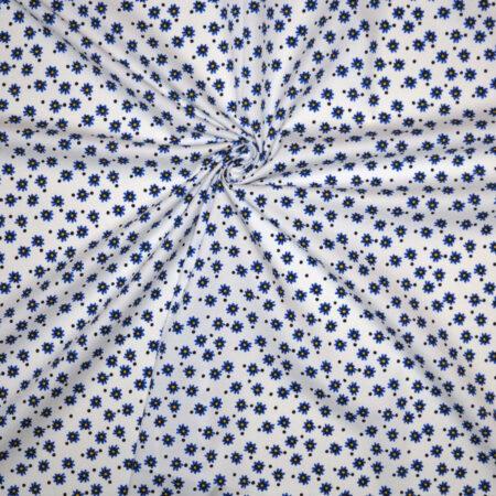 Tessuto cotone stretch imprimè fiorellini blu e pois