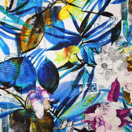 Tessuto jersey viscosa lettere fiori e farfalle blu giallo fuxia