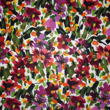 Tessuto jersey viscosa lucida pennellate floreale colori caldi