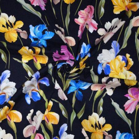 Tessuto envers satin seta disegno iris multicolor fondo nero