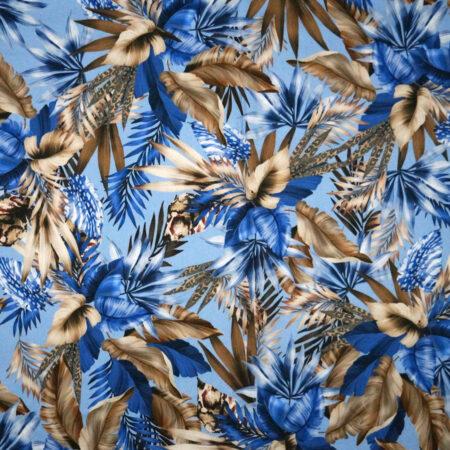 Tessuto cotone stretch stampato disegno foglie blu e marroni fondo azzurro