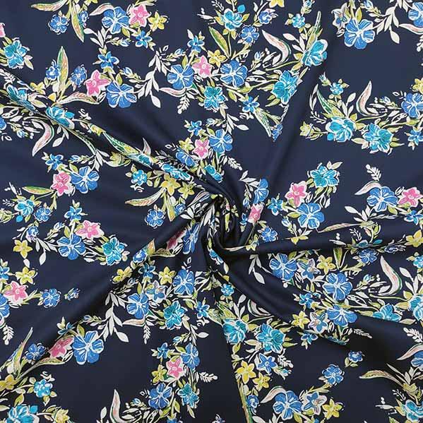 Cotone elastico floreale fondo blu