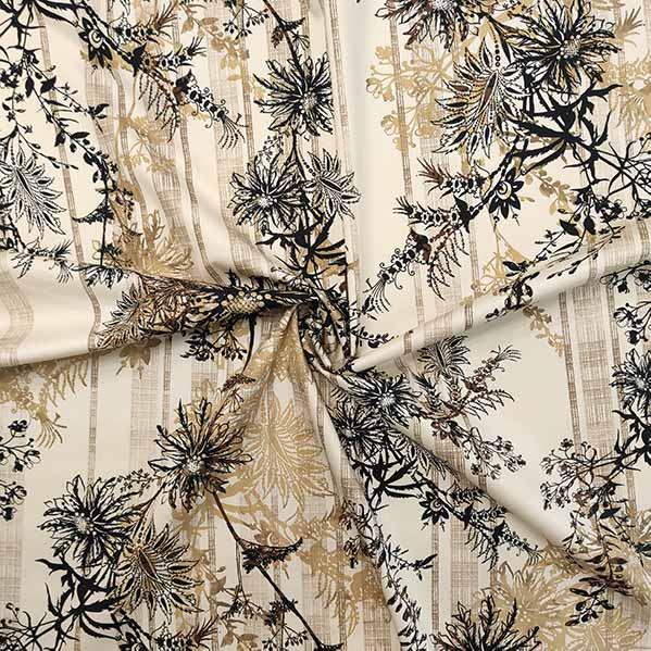 Cotone stretch stampato fiori stilizzati su fondo beige