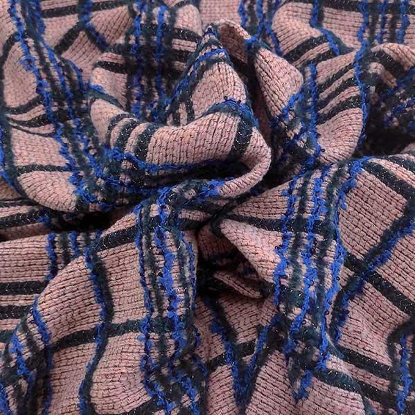 Tessuto misto lana quadro su rosa