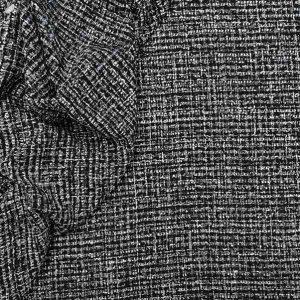 Tweed bouclè e nastri toni nero
